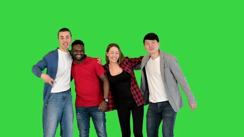 Group of Young People Smiling and Laughing in Front of Camera Thumbs Up on a Green Screen Chroma Key