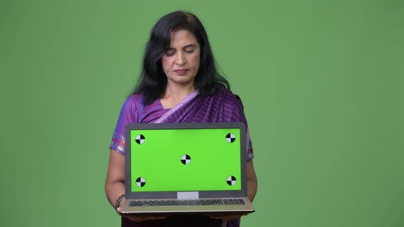 Thumbnail for Mature Beautiful Indian Woman Showing Laptop