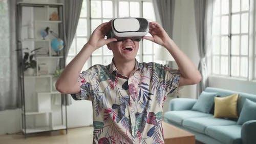 Man Explores Virtual Reality At Living Room