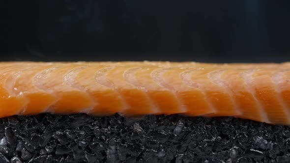 Thumbnail for Salmon Is Scorched with Gas-burner in Slow Motion ,Making the Sushi Roll with Black Rice and Salmon