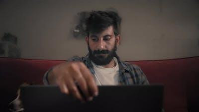 Man opening laptop and starting to work