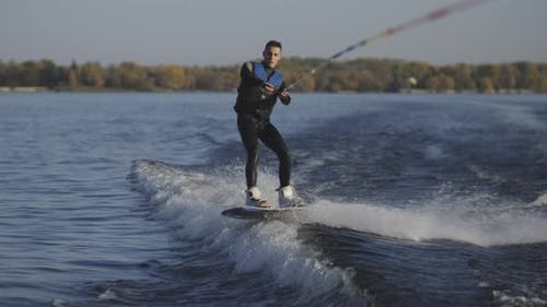 Wakeboarder Falling in Water