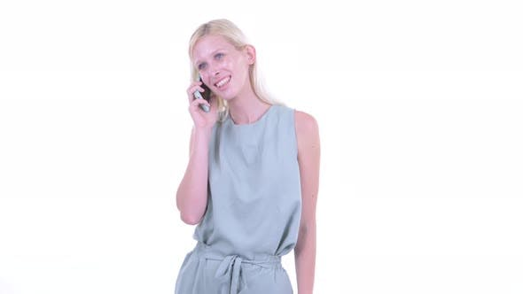 Cover Image for Happy Young Beautiful Blonde Woman Talking on the Phone