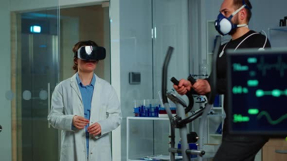 Scientist Doctor in Sport Science Laboratory Wearing Virtual Reality Goggles