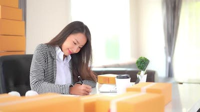 Young asian woman use laptop
