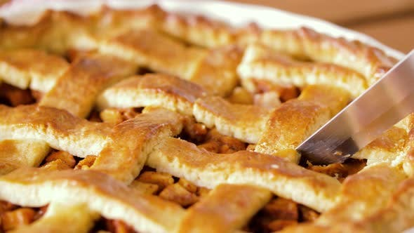 Thumbnail for Close Up of Apple Pie Slicing By Knife 22