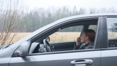 A Young Woman Crashes While Driving a Car
