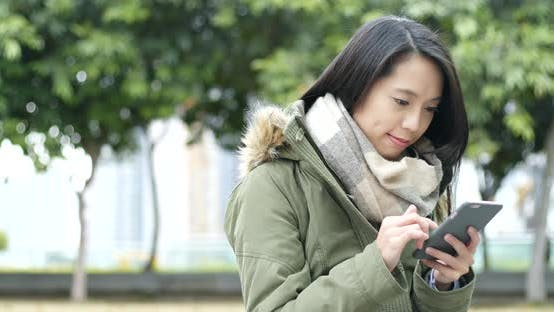 Cover Image for Woman use of smart phone at outdoor