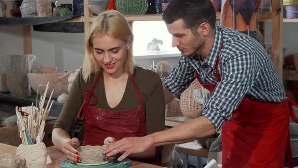 Thumbnail for Young Couple Enjoying Working with Clay at the Pottery Workshop