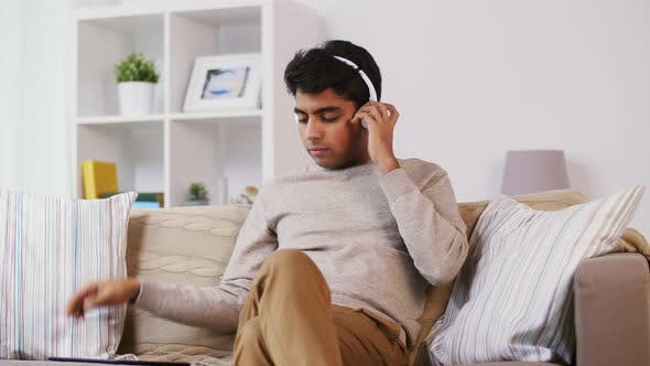 Thumbnail for Indian Man with Tablet Pc and Headphones at Home 60