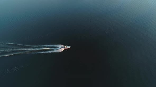 Thumbnail for Motor Boat on River and Barge at Sunrise