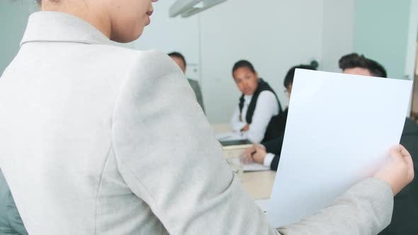 Thumbnail for Woman Giving Presentation During Meeting
