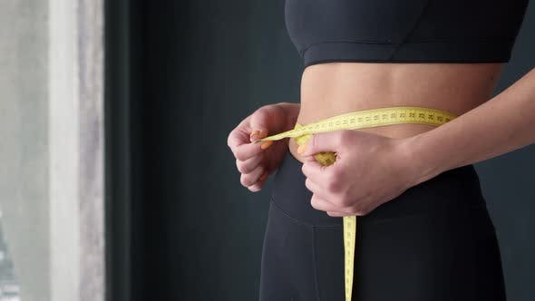 Thumbnail for Fitness Woman With Tape Measure Showing Her Waist