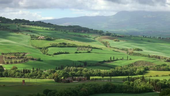 Thumbnail for Shadows of Clouds Slide on Hills of Tuscany, Italy