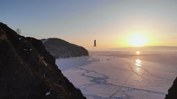 Thumbnail for The Tightrope Walker Is on a Rope Stretched Between the Rocks at High Altitude.