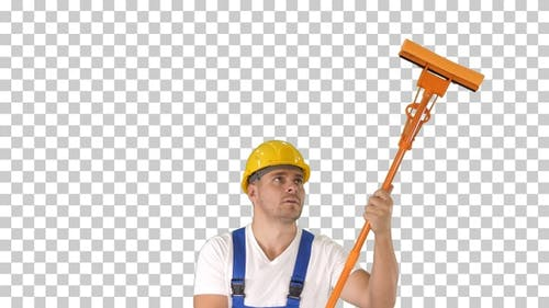 Smiling mid adult worker cleaning window with squeegee