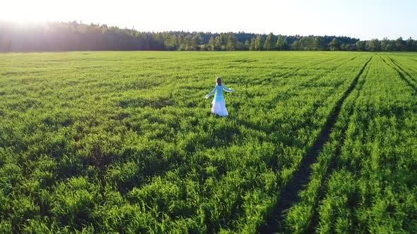 Thumbnail for Girl Walking On Sunlight Field 6