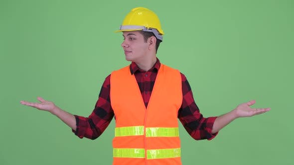 Thumbnail for Happy Young Multi Ethnic Man Construction Worker Comparing Something