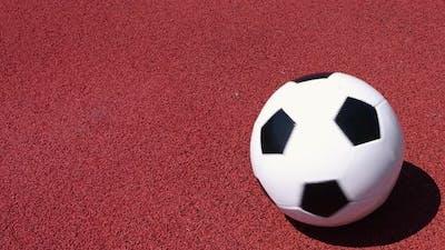 Football ball spinning on red field