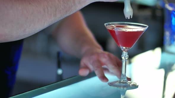 Thumbnail for Barman Serving Cocktail