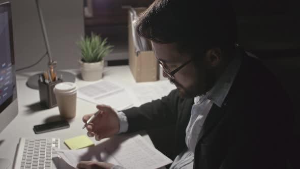 Thumbnail for Man Analyzing Financial Data