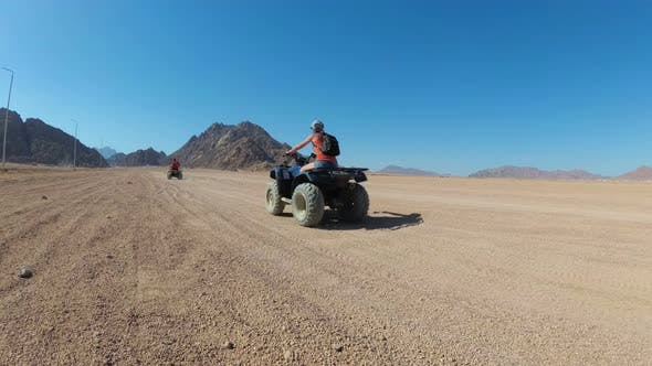Thumbnail for Sexy Woman Is Riding a Quad Bike in the Desert of Egypt. Dynamic View in Motion