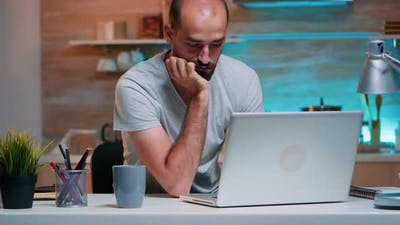 Business Man Sleeping in Front of Laptop