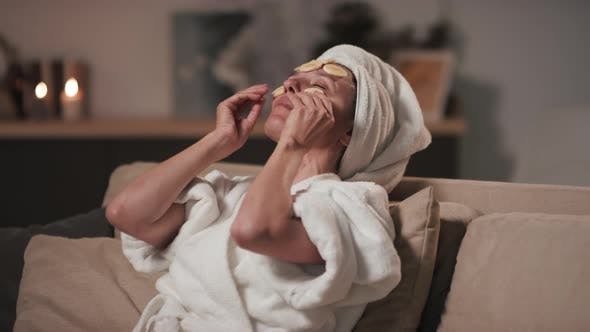 Thumbnail for Woman Chilling With Banana Slices On Face