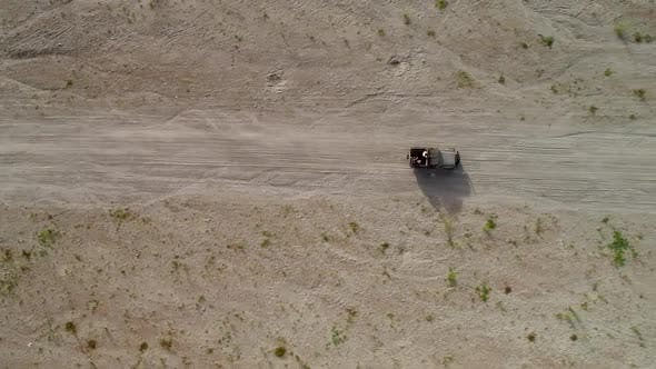 Thumbnail for Aerial view above road in valley with a off road jeep in Tarlac, Philippines.