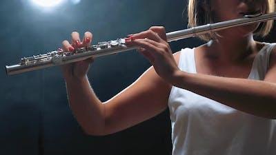 Musician Female Playing on Flute. Smoky Studio