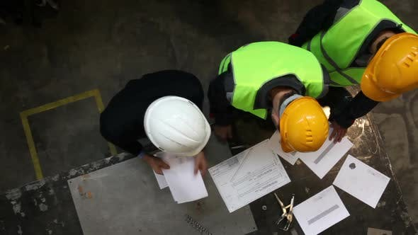 Thumbnail for Workers in Hardhats at Factory