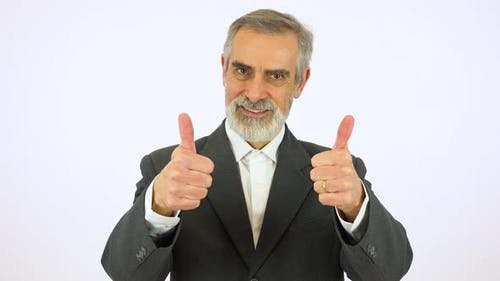 An Elderly Man Smiles and Shows a Double Thumb Up To the Camera - White Screen Studio