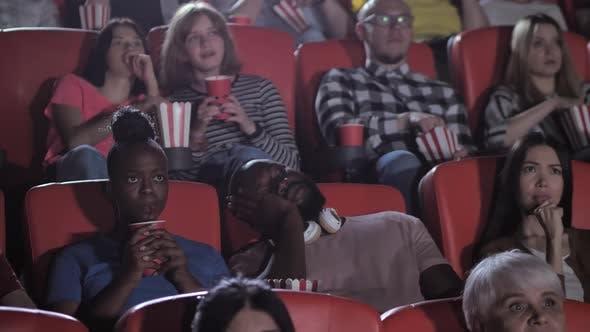 Dark-skinned Male Spectator Sleeping During Movie