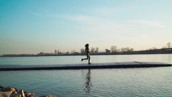 Athletic Girl Running Pier Along Lake Background Beautiful Sunset