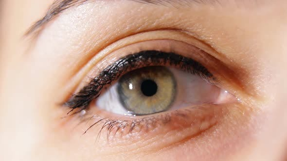 Thumbnail for Macro Close-up of Womens Eye Opening.