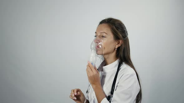 Thumbnail for Doctor set up a nebulizer and demonstrates how it works