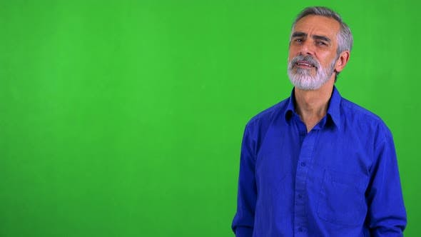 Thumbnail for Old Senior Man Points To Camera with Finger - Green Screen - Studio