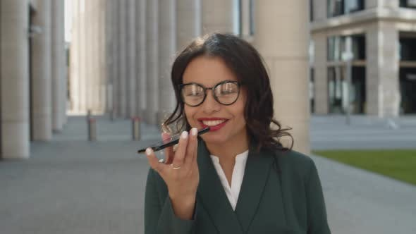 Businesswoman Talking on Phone and Walking