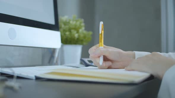 Thumbnail for Business Woman Writing On Notebook