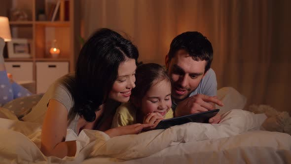Thumbnail for Happy Family with Tablet Pc in Bed at Home