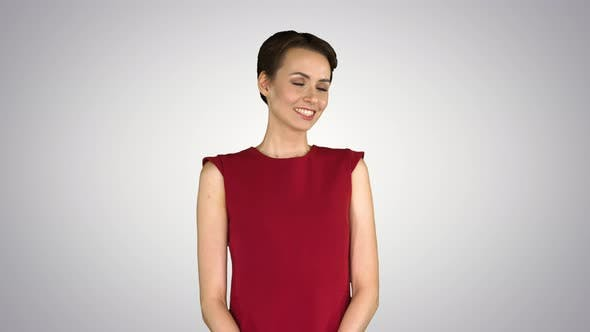 Cover Image for Elegant Young Woman Agrees with Someone and Smiling To Camera on Gradient Background