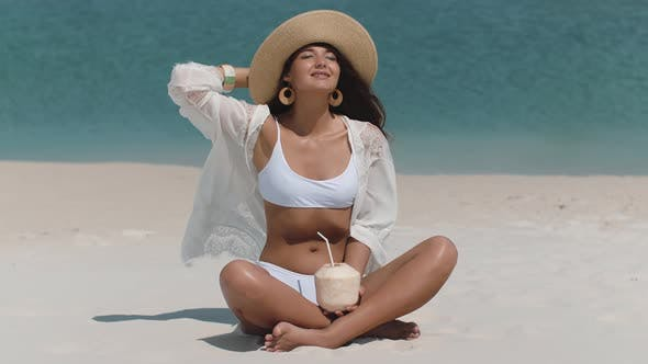 Thumbnail for Tanned Woman in Bikini with Coconut on the Beach