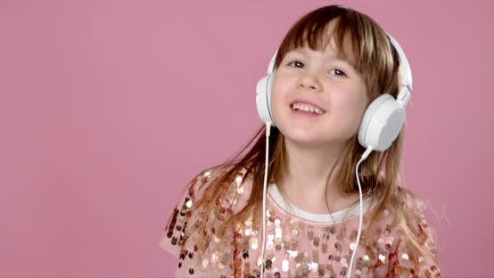 Thumbnail for Pretty 6 or 7 Years Old Little Girl Singing and Dancing with Headphones