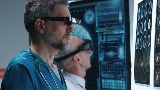 Cover Image for Doctors Examining Brain Scan with VR Headset