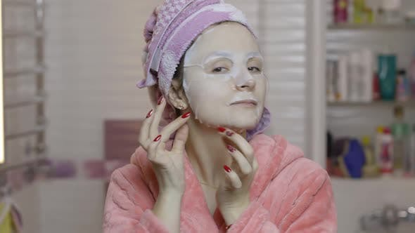 Thumbnail for Woman Applying Cosmetic Face Mask in Bathroom. Skincare Spa. Facial Mask