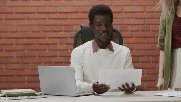 African-American Male Designer Having Video Meeting with Customer