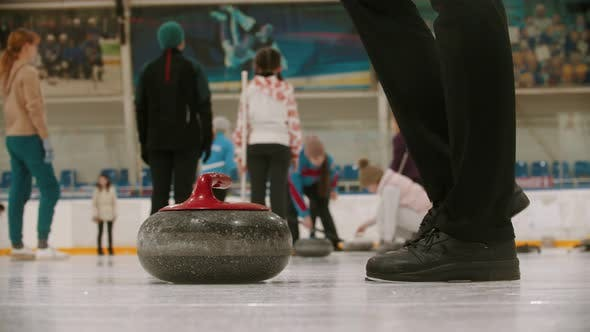 Thumbnail for Curling Training - a Young Woman Pushes Off From the Stand with Granite Stone