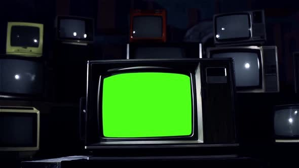 Vintage TV with Green Screen and a Retro TV Stack Installation. Blue Tone.