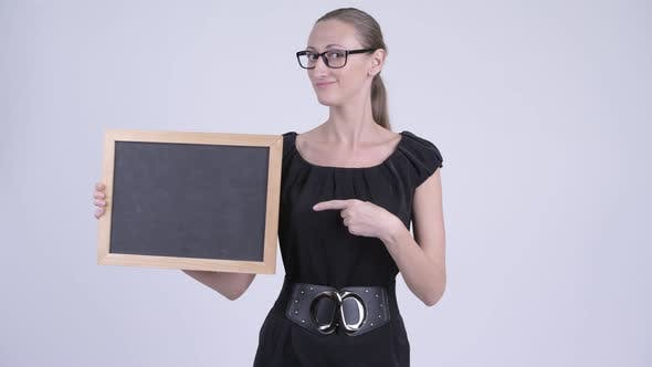 Thumbnail for Happy Blonde Businesswoman Holding Blackboard and Giving Thumbs Up