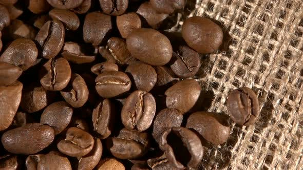 Thumbnail for Handful of Brown, Roasted Coffee Beans on Burlap Sacking, Background, Close Up, Rotation